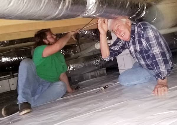 Two Home Inspectors at a Home Inspection